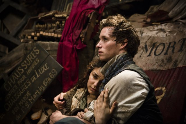 Samantha Barks and Eddie Redmayne star as Eponine and Marius in 'Les Misérables.'