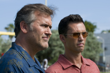 "BURN NOTICE -- ""Hot Spot"" Episode 211 -- Pictured: (l-r) Bruce Campbell as Sam Axe, Jeffrey Donovan as Michael Westen -- USA Network Photo: Glenn Watson"