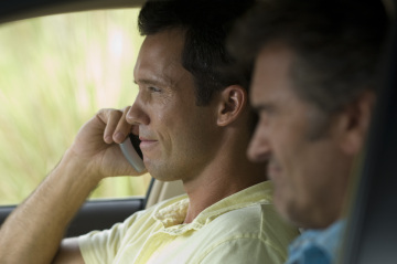 "BURN NOTICE -- ""Scatter Point"" Episode 205 -- Pictured: (l-r) Jeffrey Donovan as Michael Westen, Bruce Campbell as Sam Axe -- USA Network Photo: Glenn Watson"