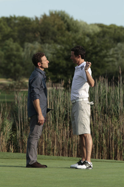 "ROYAL PAINS -- Episode 312 -- ""Some Pig"" -- Pictured: (l-r) Mark Feuerstein as Hank Lawson, Tom Cavanagh as Jack O'Malley -- Photo by: Giovanni Rufino/USA Network"