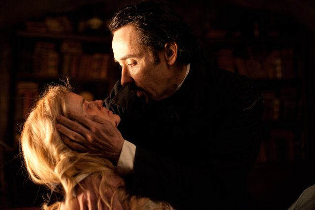 "John Cusack plays Edgar Allen Poe and Alice Eve as Emily Hamilton in the Relativity Media film ""The Raven."""