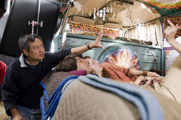 Ang Lee works on a scene in 'Taking Woodstock' with Demetri Martin and Paul Dano.