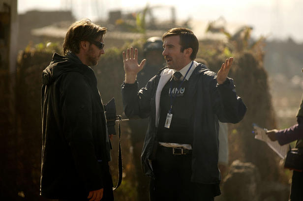 Neill Blomkamp discusses a scene with star Sharlto Copley on the set of 'District 9.'