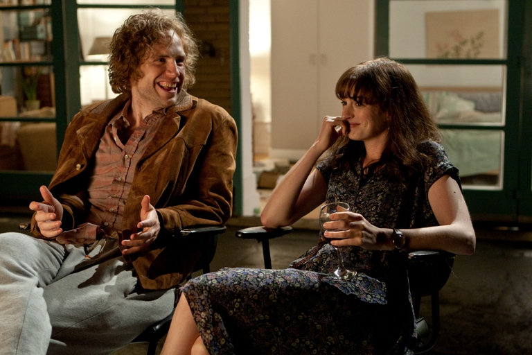 Rafe Spall (left) and Anne Hathaway (right) star as Ian and Emma in the romance ONE DAY, a Focus Features release directed by Lone Scherfig.