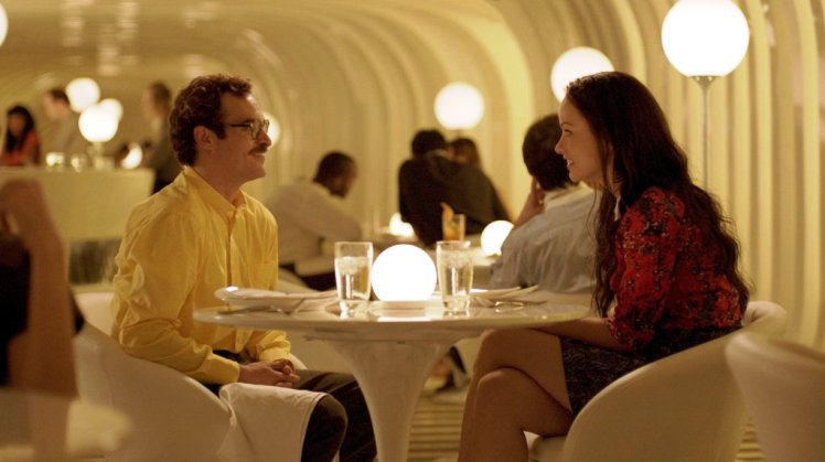 Joaquin Phoenix and Olivia Wilde star in 'Her.'