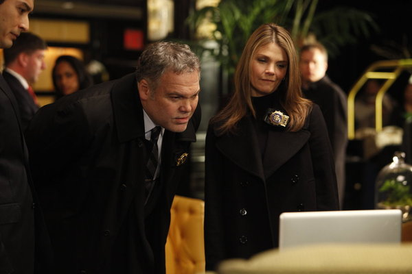 "LAW & ORDER: CRIMINAL INTENT -- ""The Consoler"" -- Pictured: (l-r) Vincent D'Onofrio as Detective Robert Goren, Kathryn Erbe as Detective Alex James -- Photo by: Will Hart/USA Network"