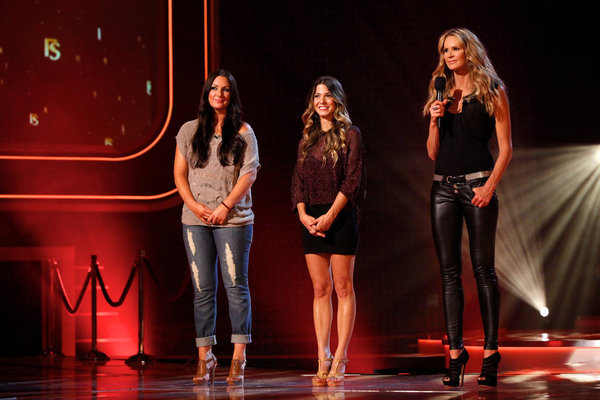 "FASHION STAR -- ""High-End Appeal/Mass Market Appeal"" Episode 104 -- Pictured: (l-r) Sarah Parrott, Orly Shani, Elle Macpherson -- (Photo by: Tyler Golden/NBC)"