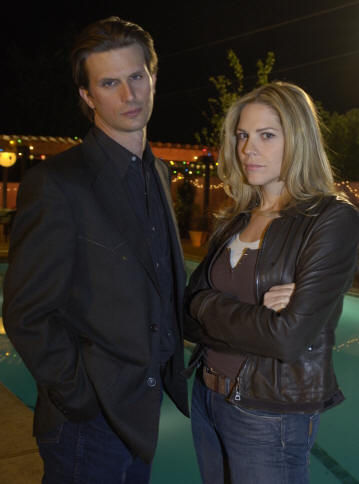 Fred Weller and Mary McCormack in the series 'In Plain Sight.'