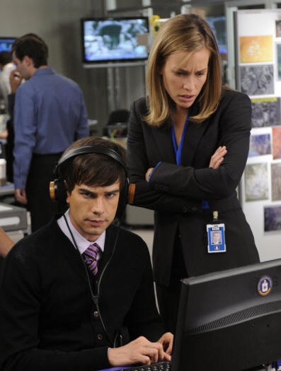 COVERT AFFAIRS -- Episode 101 -- Pictured: (l-r) Christopher Gorham as Auggie Anderson, Piper Perabo as Annie Walker -- Photo by: Steve Wilkie/USA Network