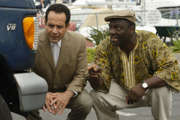 "MONK -- ""Mr. Monk and the Foreign Man"" Episode 8007 -- Pictured: (l-r) Tony Shalhoub as Adrian Monk, Adewale Akinnuoye-Agbaje as Samuel -- USA Network Photo: Hopper Stone"