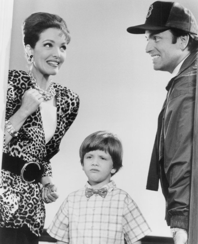 Amy Yasbeck, Michael Oliver and John Ritter in 'Problem Child.'